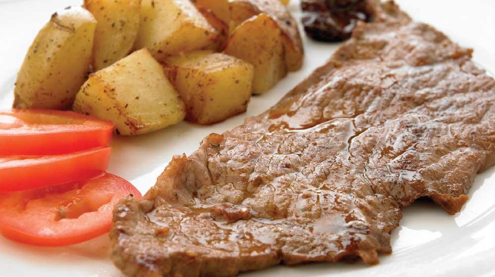 Rico bistec con papas aromáticas